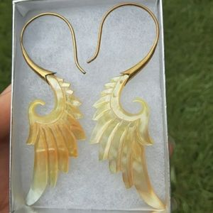 Hand carved mother of pearl tribal wing earrings